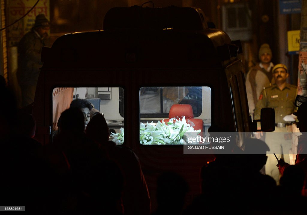 An ambulance transporting the body of a gang-rape victim is seen outside her residence in New Delhi on December 30, 2012. The body of a gang-rape victim arrived back in New Delhi on December 30 after her death from sickening injuries in a Singapore hospital as India was engulfed by a mass outpouring of grief and anger.