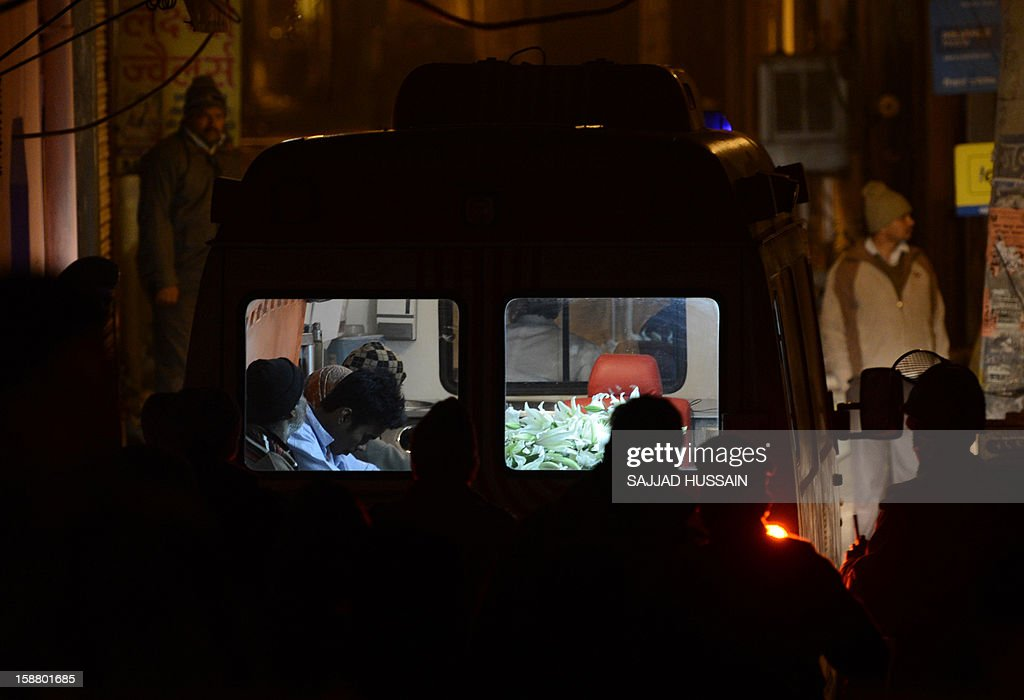 An ambulance transporting the body of a gang-rape victim is seen outside her residence in New Delhi on December 30, 2012. The body of a gang-rape victim arrived back in New Delhi on December 30 after her death from sickening injuries in a Singapore hospital as India was engulfed by a mass outpouring of grief and anger. AFP PHOTO/SAJJAD HUSSAIN