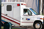 An ambulance with husband Mark Kelly in the passenger seat transfers US Rep Gabrielle Giffords from the ICU at Memorial Hermann Hospital to the Texas...
