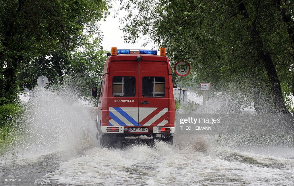 An ambulence makes its way through the flooded roads near the Polish town of Kostrzyn on May 28, 2010. Torrential rain in Poland's mountainous south have caused rivers swell and the flood warning level has risen in Germany.