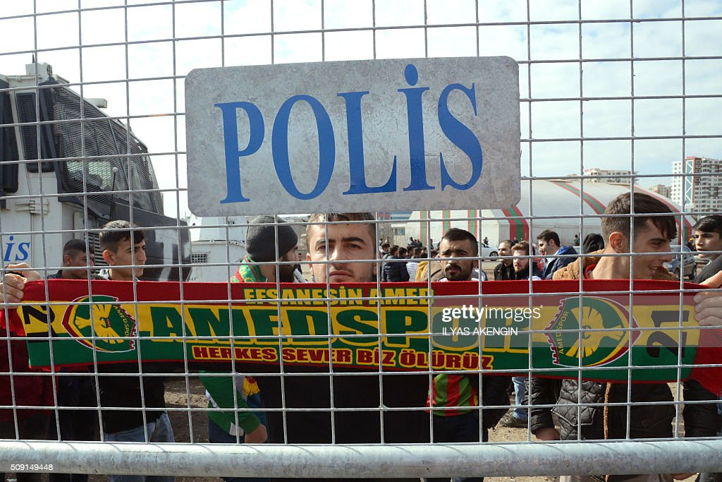 An Amedspor's supporter waves a scarf to cheer his team prior to the Turkish Cup football match between Amed Spor and Fenerbahce Zirrat on February 9, 2016 in Diyarbakir. The Turkish Football Federation said on February 5, 2016 it had suspended a Kurdish player for statements considered 'ideological propaganda' on the conflict in the Kurdish-majority southeast, adding to a string of cases cracking down on freedom of expression in Turkey. AKENGIN