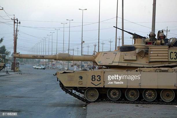 An American Abrams M1 tank from the 1st Cavalry Division 2nd Battalion 7th Cavalry takes up a position on a deserted street August 13 2004 in Najaf...