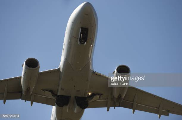 An American Airlines Airbus A319 airplane takes off from Ronald Reagan Washington National Airport in Arlington Virginia August 15 2016 / AFP / SAUL...
