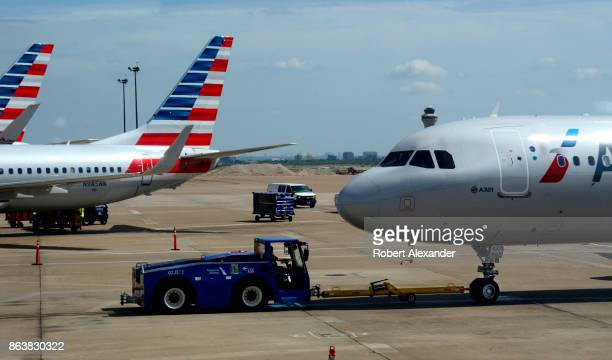An American Airlines Airbus A321 passenger jet is pushed from the gate at Dallas/Fort Worth International Airport in Texas