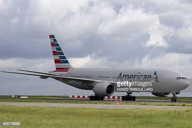 An American Airlines aircraft drives on the tarmac at the RoissyCharlesdeGaulle airport in RoissyenFrance on August 18 2014 AFP PHOTO / KENZO...