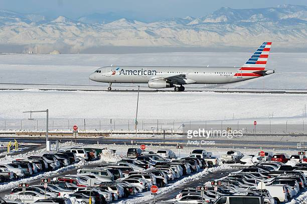 An American Airlines airplane taxis to prepare for takeoff at Denver International Airport March 24 2016 Thousands of passengers that were stranded...