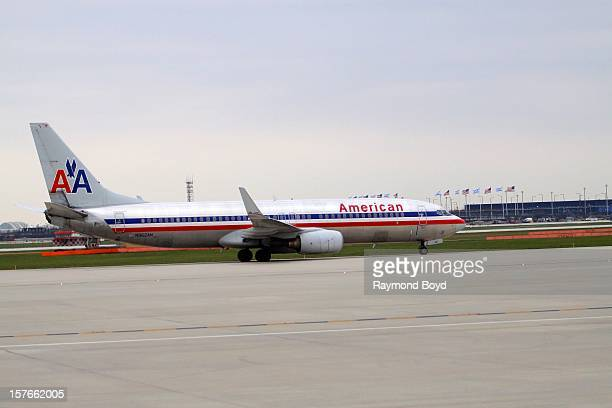 An American Airlines airplane taxis up the runway to prepare for takeoff at O'Hare International Airport in Chicago Illinois on OCTOBER 25 2012