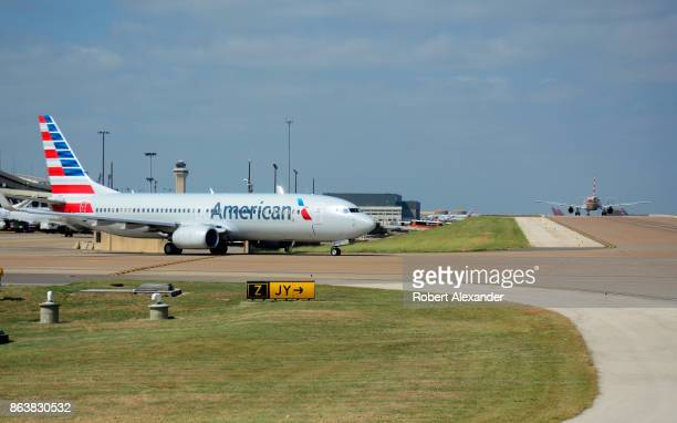 An American Airlines Boeing 737 passenger jet taxis at the Dallas/Fort Worth International Airport located roughly halfway between Dallas and Fort...