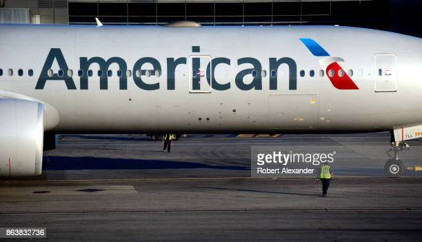 An American Airlines Boeing 777 passenger jet is towed to a gate at John F Kennedy International Airport in New York New York