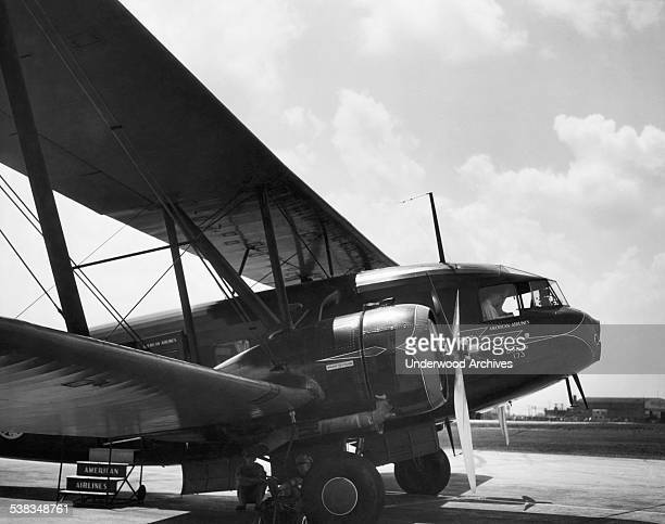 An American Airlines Curtiss T32 Condor biplane outfitted as a 12 passenger luxury night sleeper transport plane at Municipal Airport later known as...