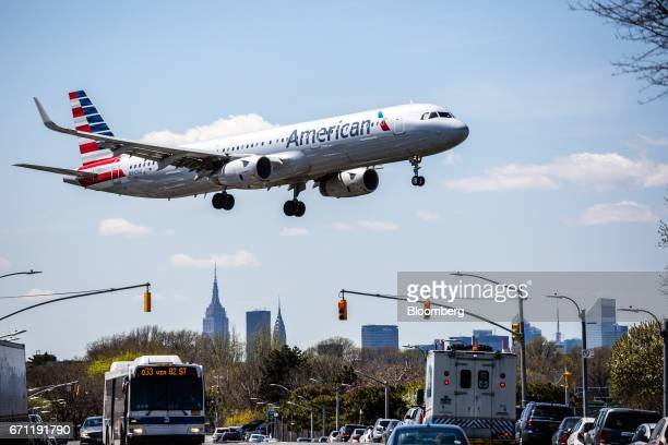 An American Airlines Group Inc plane prepares for landing at LaGuardia Airport in New York US on Tuesday April 18 2017 An additional section of land...
