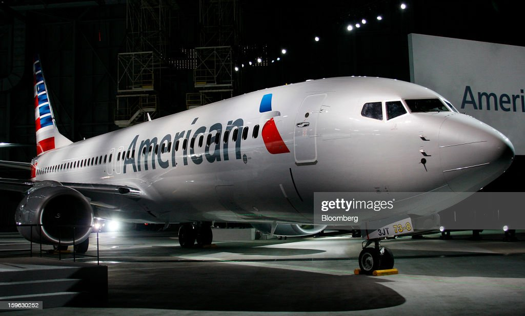 An American Airlines Inc. Boeing Co. 737-800 plane is displayed during an event at Dallas-Fort Worth International Airport in Fort Worth, Texas, U.S., on Thursday, Jan. 17, 2013. American Airlines unveiled the first change in its aircraft livery in more than 40 years as it nears a decision on merging with US Airways Group Inc. or trying to leave bankruptcy on its own. Photographer: Mike Fuentes/Bloomberg via Getty Images