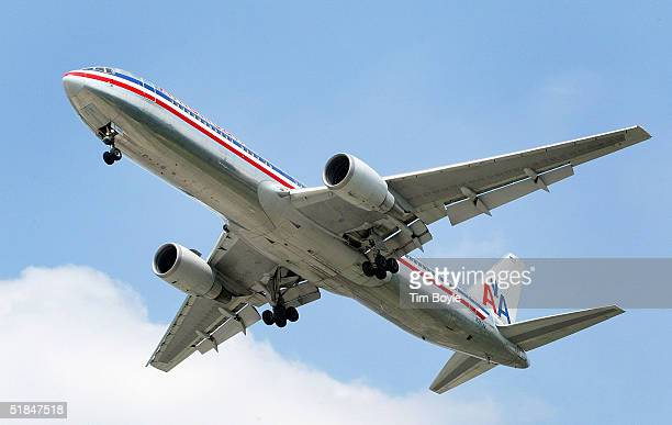 An American Airlines jet is seen in the air preparing to land September 3 2004 at Chicago's O'Hare International Airport in Rosemont Illinois...