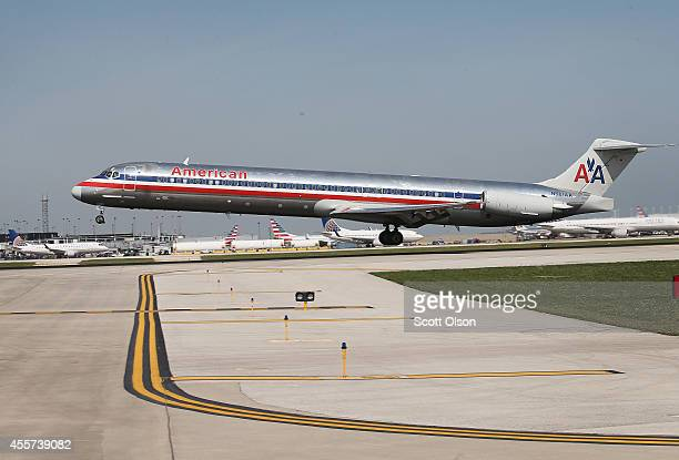 An American Airlines jet lands at O'Hare International Airport on September 19 2014 in Chicago Illinois In 2013 67 million passengers passed through...