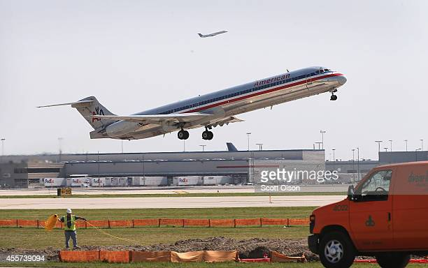 An American Airlines jet takes off from O'Hare International Airport on September 19 2014 in Chicago Illinois In 2013 67 million passengers passed...