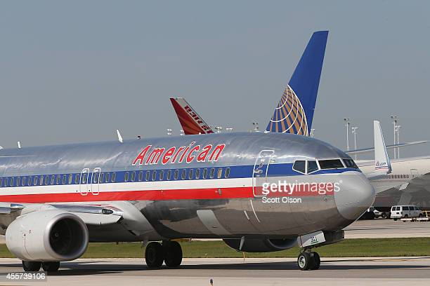 An American Airlines jet taxis at O'Hare International Airport on September 19 2014 in Chicago Illinois In 2013 67 million passengers passed through...