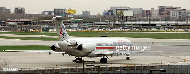 An American Airlines jet taxis near its runway April 13 2006 at O'Hare International Airport in Chicago Illinois Hoping in part to eliminate current...