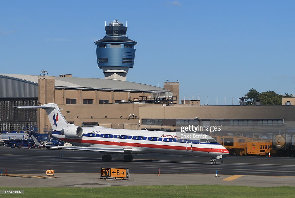 An American Airlines jet taxis on the runway at Laguardia Airport on August 14 2013 in New York New York