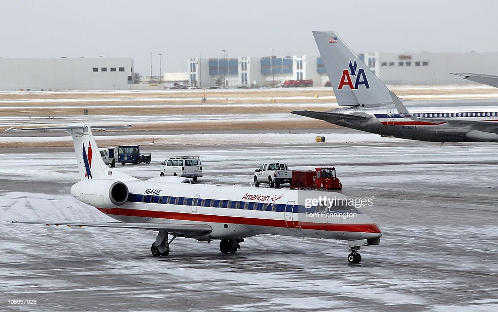 An American Airlines jet taxis to a gate after an overnight ice storm forced the closure of DFW International Airport on February 1, 2011 in Dallas, Texas. A major ice storm hit the Dallas/Fort Worth area overnight days before Super Bowl XLV is to be be held in Arlington, Texas.