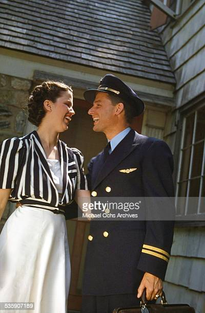 An American Airlines pilot says goodbye to his wife at home