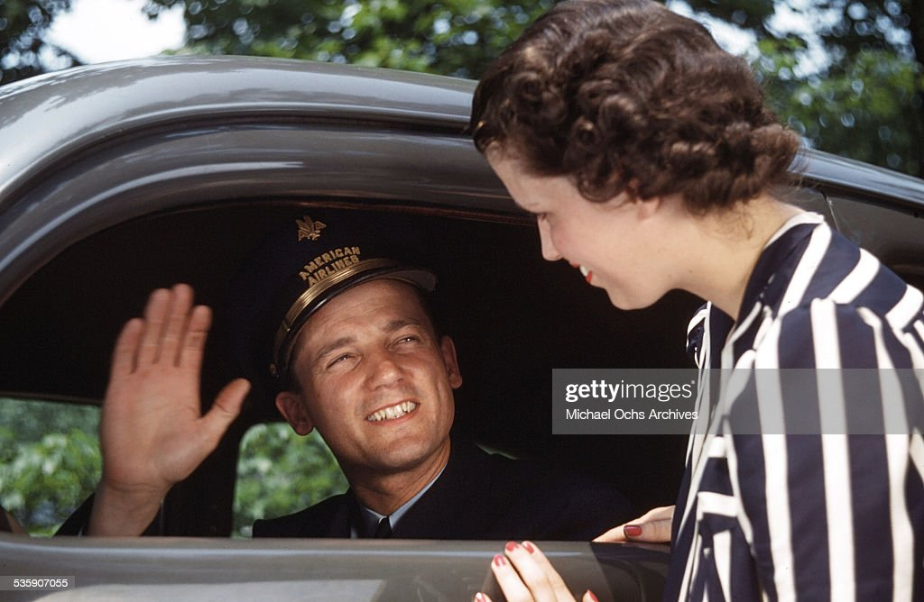 An American Airlines pilot waves goodbye to his wife.