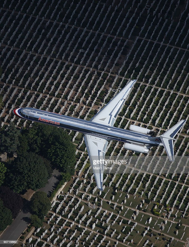 An American Airlines plane flies over a cemetery September 13, 2009 in the Queens borough of New York City.