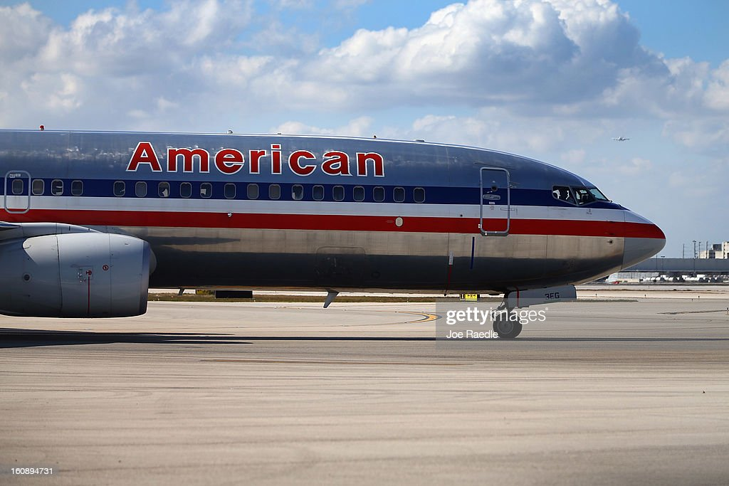 An American Airlines plane is seen at the Miami International Airport on February 7, 2013 in Miami, Florida. Reports indicate that a deal between American Airlines and US Airways to merge may be set for early next week. If the deal goes through it would create the world's biggest airline.