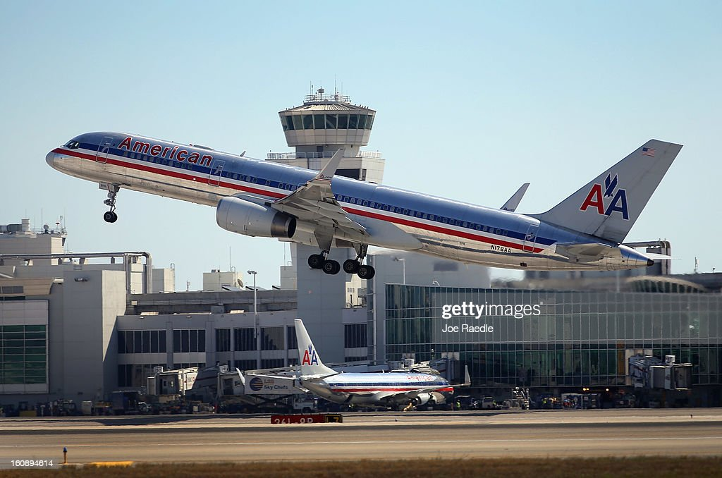 An American Airlines plane takes off at the Miami International Airport on February 7, 2013 in Miami, Florida. Reports indicate that a deal between American Airlines and US Airways to merge may be set for early next week. If the deal goes through it would create the world's biggest airline.