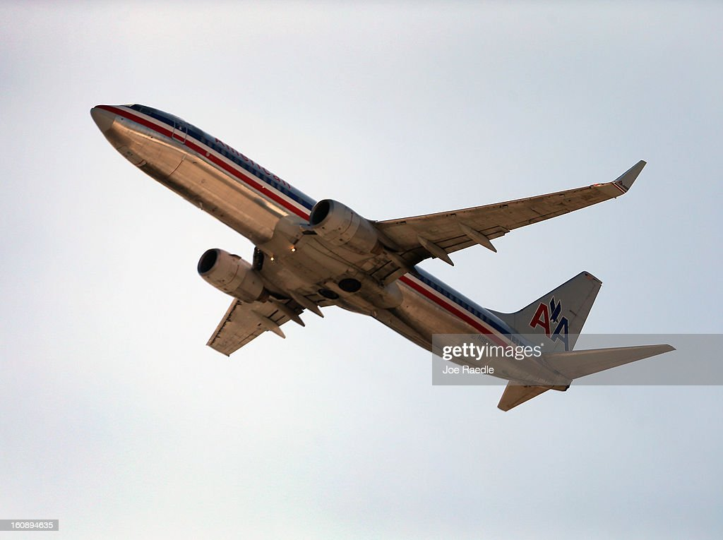 An American Airlines plane takes off from the Miami International Airport on February 7, 2013 in Miami, Florida. Reports indicate that a deal between American Airlines and US Airways to merge may be set for early next week. If the deal goes through it would create the world's biggest airline.