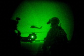 An American blackhawk helicopter lands as Soldiers with the 509th Infantry Division and the 3rd Infantry's Aviation Brigade launched a joint air...