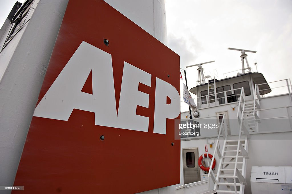 An American Electric Power (AEP) River Operations logo hangs on the side of an exhaust stack aboard the Capt. Bill Stewart tow boat as it pushes grain barges on the Mississippi River south of St. Louis, Missouri, U.S., on Friday, Dec. 7, 2012. Barges carrying grain, soybeans, coal, oil and other commodities on the Mississippi River have started to reduce their loads to navigate waters shrunk by the worst drought in 50 years. Photographer: Daniel Acker/Bloomberg via Getty Images