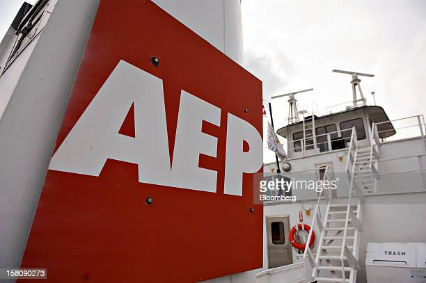 An American Electric Power River Operations logo hangs on the side of an exhaust stack aboard the Capt Bill Stewart tow boat as it pushes grain...