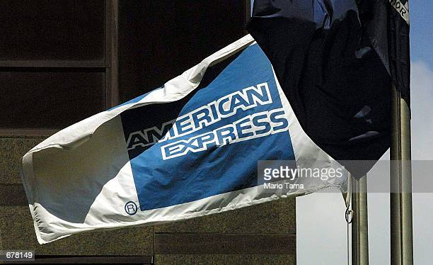 An American Express flag blows in the wind in front of the American Express corporate headquarter building July19 2001 in New York City The financial...