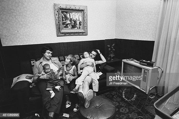 An American family relaxing at home on the sofa 1975