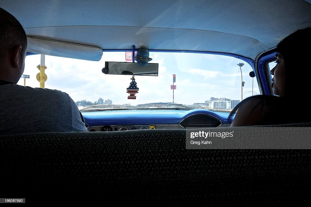 An American flag air freshener hangs from the rear view mirror of a cab ion November 12, 2012 in Havana, Cuba. New business regulations in the communist country have allowed thousands of citizens to make money for themselves for the first time since 1959.