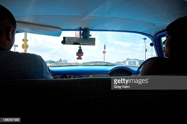 An American flag air freshener hangs from the rear view mirror of a cab ion November 12 2012 in Havana Cuba New business regulations in the communist...