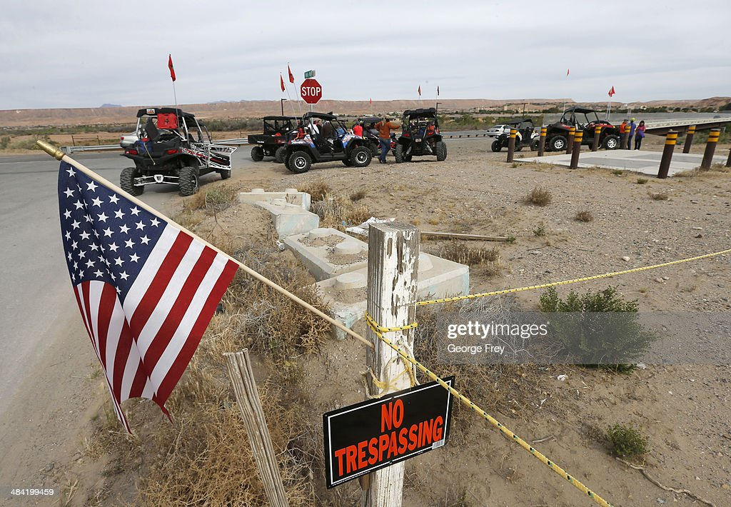 An American flag flies as ATV riders prepare to enter closed BLM land along U.S. 170 on April 11, 2014 west of Mesquite, Nevada. Bureau of Land Management officials are rounding up Cliven Bundy's cattle, he has been locked in a dispute with the BLM for a couple of decades over grazing rights. (Photo by George Frey/Getty Images