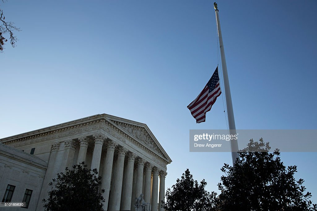 An American flag flies at half mast following the death of Supreme Court Justice Antonin Scalia at the U.S. Supreme Court, February 14, 2016 in Washington, DC. Supreme Court Justice Antonin Scalia was at a Texas Ranch Saturday morning when he died at the age of 79.