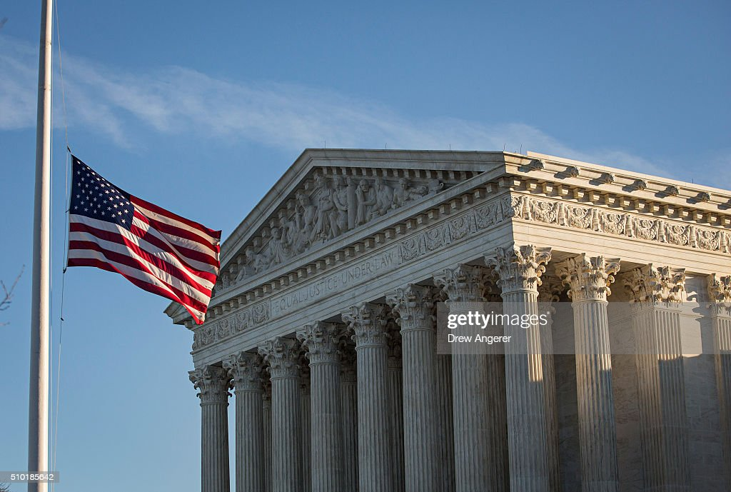 An American flag flies at half mast following the death of Supreme Court Justice Antonin Scalia at the US Supreme Court February 14 2016 in...