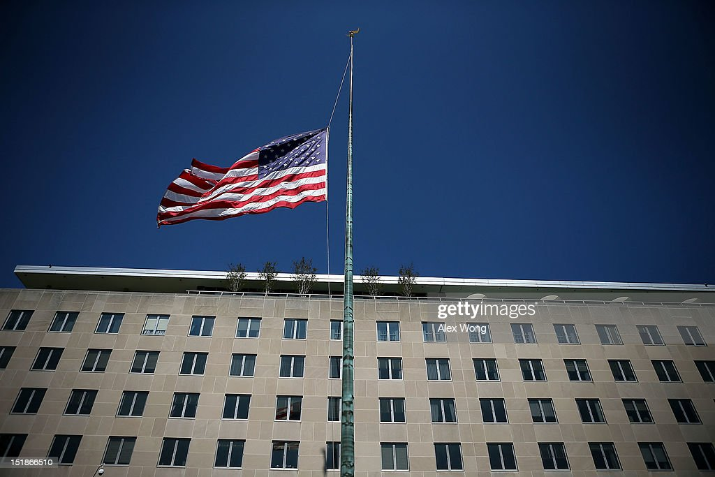 An American flag flies at half staff outside the State Department September 12, 2012 in Washington, DC. U.S. ambassador to Libya J. Christopher Stevens and three other embassy employees who were killed when the embassy in Benghazi was attacked by a mob potentially angered by an American-made video mocking Islam's founding prophet.
