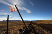 An American flag flies at the USMexico border on February 26 2013 near Sonoita Arizona The Federal government has increased the Border Patrol...