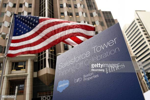 An American flag flies during a topping off ceremony for the Salesforce Tower in San Francisco California US on Thursday April 6 2017 The Salesforce...