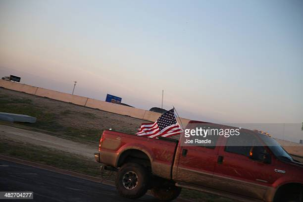 An American flag flies from the back of a pickup truck near Fort Hood where Iraq war veteran Ivan Lopez killed three and wounded 16 before taking his...