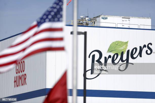 An American flag flies in front of Breyers and Good Humor brand signage outside the Unilever Plc facility in Covington Tennessee US on Tuesday Oct 3...