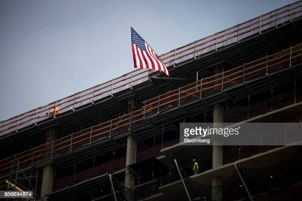 An American flag flies outside the 416 Kent Avenue apartment development under construction in the Williamsburg neighborhood of the Brooklyn borough...