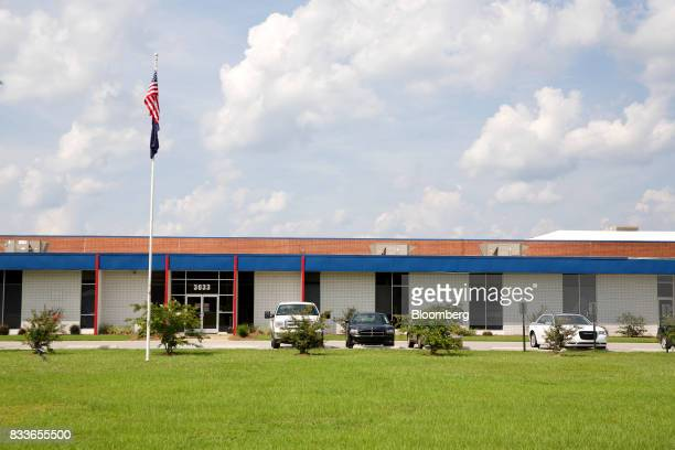 An American flag flies outside The Kent International Inc Bicycle Corporation of America brand Assembly facility in Manning South Carolina US on...