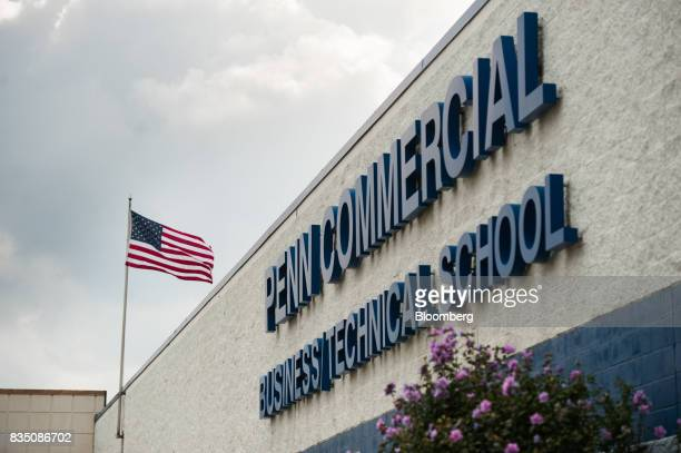 An American flag flies outside the Penn Commercial Business/Technical School in Washington Pennsylvania US on Tuesday Aug 15 2017 While fracking has...