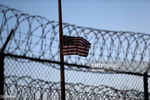 An American flag flies over Camp VI at the US military prison for 'enemy combatants' on June 26 2013 in Guantanamo Bay Cuba President Barack Obama...