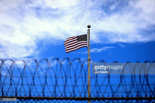 An American flag flies over Camp VI the US military prison for 'enemy combatants' on June 25 2013 in Guantanamo Bay Cuba President Barack Obama has...