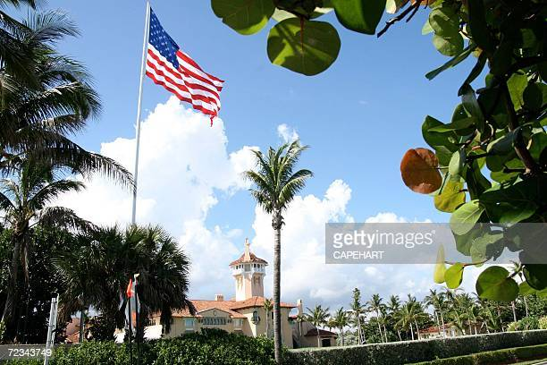 An American flag flies over Donald Trump's MarALago club November 1 2006 in Palm Beach Florida The town of Palm Beach has cited Donald Trump because...